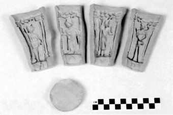 Fig. 5: Terra-cotta mold panels and disk made for the reproduction of a mythological beaker. (Photo: author)