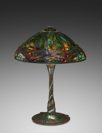 """""""Dragonfly"""" reading lamp, about 1905. Tiffany Studios, designed attributed to Clara Pierce Wolcott Driscoll (American, 1861–1944). Leaded glass, metal filigree; bronze, glass mosaic. H. 48.3 cm; Diam. 35.6 cm. The Neustadt Collection of Tiffany Glass, Queens, New York (N.86.GL.3a-c)."""