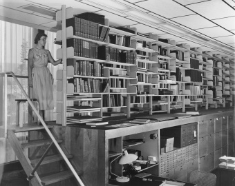 In the Library's first days, books were shelved atop a line of filing cabinets.