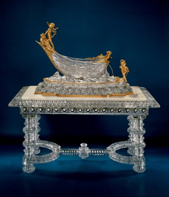 Fig. 4: Cut glass sculpture in the form of a boat mounted on a glass table with a marble top, pressed, cut; assembled on metal frame. Boat designed by Charles Vital Cornu and created by Baccarat in 1900; table designed (with glass top) by Baccarat in 1889. OH. 167 cm. The Corning Museum of Glass, Corning, New York (79.3.155).