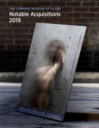 "The front cover of a book with the title ""Notable Acquisitions 2019"" in white bold letters at the top, and a photograph of a metallic, reflective rectangular with numbers searched on the surface and a person facing away"