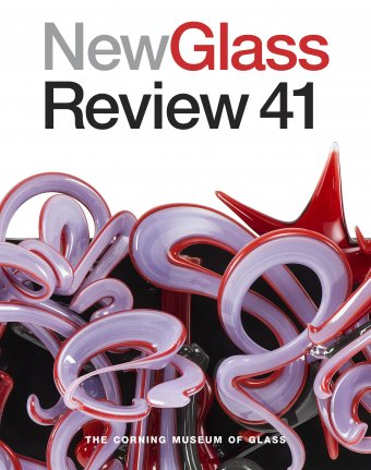 "The front cover of a book with the title ""New Glass Review 41"" in bold letters at the top, and a close-up of a purple, red, and black glass sculpture that looks like graffiti"