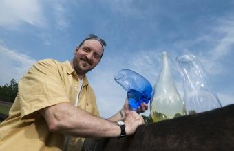 "Designer James Victore with his ""Drunken Vessel"" prototypes for GlassLab on Governors Island"