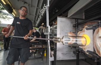 Glassmaker Jason Minami works with designer Leon Ransmeier at GlassLab on Governors Island, July 2012
