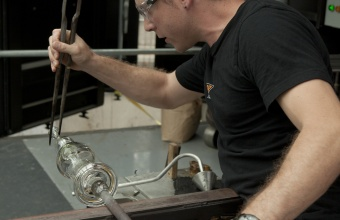Gaffer Chris Rochelle works on a prototype by illustrator Peter Sís