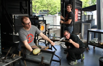 Glassmakers Eric Meek and George Kennard work with designer Sigga Heimis in a GlassLab session in Corning, May 2012
