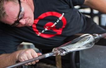 Gaffer George Kennard works with designer Tom Scott at GlassLab in Corning