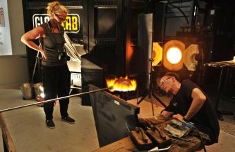 Sigga Heimis looks on as glassmaker D.H. McNabb works on her design prototype