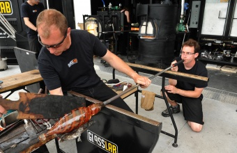 Glassmakers Eric Meek and Dan Mirer work on a prototype by designer James Irvine