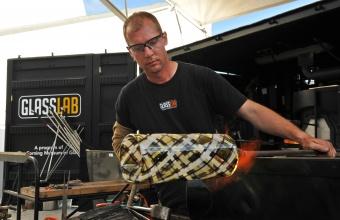 Glassmaker Eric Meek works on a design prototype by James Irvine at GlassLab