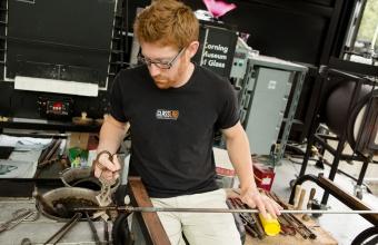 Glassmaker Dane Jack works with designer Michele Oka Doner at GlassLab in Corning, August 2012