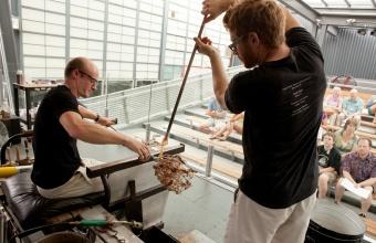 Glassmakers G Brian Juk and Dane Jack work with designer Michele Oka Doner at GlassLab in Corning, August 2012