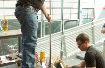 Glassmakers George Kennard and Tom Ryder work with Harry Allen and Chris Hacker at GlassLab in Corning, August 2012