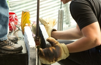 Glassmaker Tom Ryder works with Harry Allen and Chris Hacker at GlassLab in Corning, August 2012