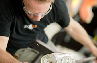 Gaffer Chris Rochelle works with Tim Dubitsky at GlassLab in Corning, August 2012