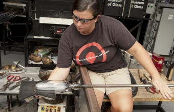 Gaffer Catherine Ayers works with Dan Ipp and Tom Zogas at GlassLab in Corning