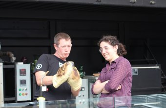 Bridget Sheehan and GlassLab glassmaker Aaron Jack look at a prototype before putting it in the annealer