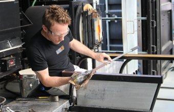 Glassmaker Chris Rochelle works on a design by GlassLab Fellowship recipient Bridget Sheehan