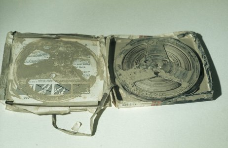 [Flood-damaged audio tapes covered with mud] [slide].