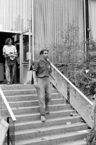 [Museum Director Paul Perrot at museum entrance during post-flood cleanup] [picture].