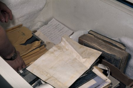 [Books and office paperwork are stored in freezer to prevent growth of mold and bacteria] [slide].