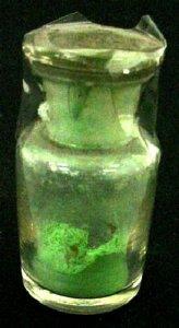 Specimen Bottle with Green Powder