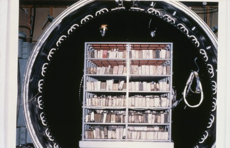 [Books are placed into the General Electric vacuum chamber to remove moisture] [slide].