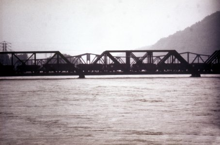 [Coal cars placed on railroad bridge to prevent flood damage] [slide].