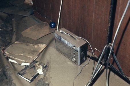 [Radio and books covered with flood mud] [slide].