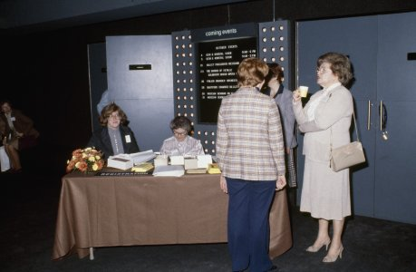 CMG Seminar 1980 [slide]: [Louise Bush and Priscilla Price at the registration table].