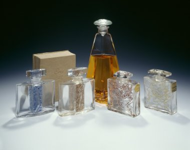 Two perfume bottles for Louvre and Claire department stores (right) [transparency]
