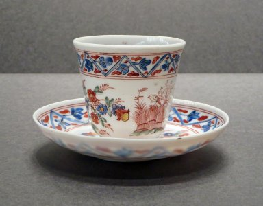 Teacup and Saucer with Enameled Floral Bouquets