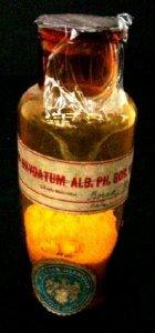 Specimen Bottle with White Powder