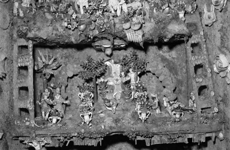 [European portable shrine covered with flood mud] [picture].