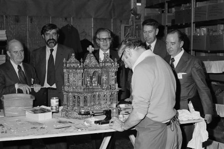 [Dr. John Martin and Dr. Robert Brill observe Albert Fehrenbacher restoring Altar to Saint Nicholas of Bari] [picture].