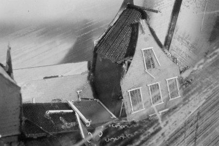 [Detailed image of flood-damaged Diorama with Dutch canal house] [picture].