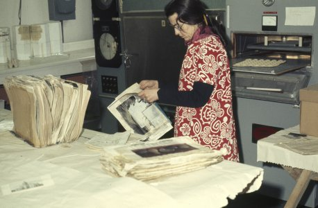 [Librarian Virginia Wright placing signatures onto drying sheets] [slide].