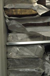 [Books are wrapped then frozen to prevent the growth of mold and bacteria, view 4] [slide].