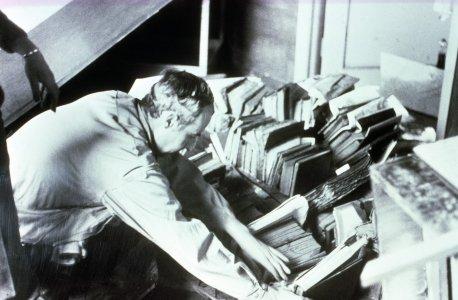 [Frank Fehlner organizing flooded rare books] [slide].
