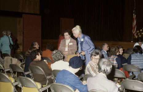 CMG Seminar, Oct. 6-8, 1977 [slide]: [Miriam Mucha and an unidentified woman chat]