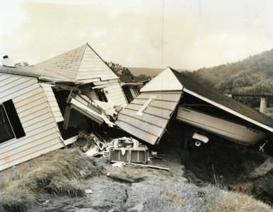 [A Houghton Plot home rest on the top of the dike following the flood of June 23, 1972] [picture].