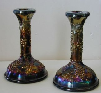 "Pair of Carnival Glass Candlesticks in ""Amethyst Grapes and Cable"" Pattern"