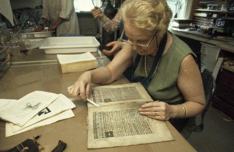 [Removing book signatures before restoration begins] [slide].