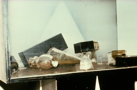 [Glassware toppled and covered with flood mud] [slide].