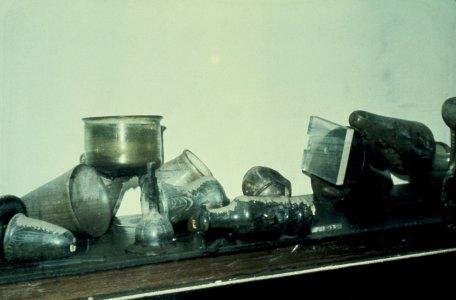 [Flood-damaged glass objects in gallery case] [slide].