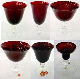 10 Glasses, 1 Candlestick