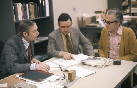 [Dr. David Fischer consults with two other chemists] [slide].