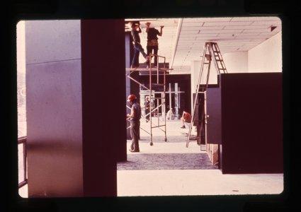 [Construction workers repairing museum galleries] [slide].