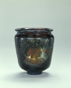 Vase with the Head of a Woman Surrounded by Foliage