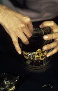[Raymond Errett restoring a flood-damaged covered beaker] [slide].